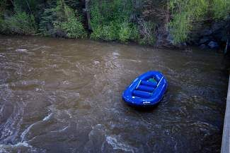 An empty raft floats down the Eagle River in Avon on May 31, one day after the river's water level was at its peak height for the season. Of the eight rafters originally in the boat, three went missing for about an hour and were eventually found after going for a swim while the remaining five went looking for them. Water levels and snowpack are 121 percent above last year's, with as much as 40 percent yet to melt at some higher elevations areas, according to Snotel data.