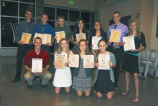 Congrats to the Eagle Valley High School cross-country team for finishing up a great season on Tuesday with their team banquet. Pictured are the 2013 Team Award Winners: Top Row: Gino Giovagnoli (MVP), Nathan Maddox (Hardest Worker, Team Player Award, Senior Survivor), Matt Jordan (Most Improved), Gabreala Gurule (Most Improved), Desy Mendoza (Fired Up and Going Nuts Every Minute Award), Domonic Patterson (Team Miles Leader) Shawna Adams (Team Miles Leader). Bottom Row: James Robinson (Senior Survivor), Michaela Mitchell (MVP), Nikki Cunning (Hardest Worker and Senior Survivor) and Emily Boyd (Team Player Award).