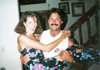 """Happy 26th wedding anniversary to Mark, my love. I know what you all are thinking ... """"Wow! Sue and Mark look just the same as they did the day he swept her off her feet"""""""