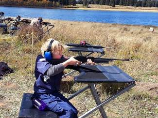 Otto Berga,of  Cub Scout Pack 229, shoots his first-place score at the