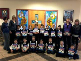 The Rotary Clubs of the Vail Valley (Vail, Edwards and Eagle) gear up every December to deliver beautiful dictionaries to third-grade students in the valley. Pictured here are Brenda Harper, Monica Donoso and Linda Hill from the Edwards Rotary Club giving the dictionaries to Karen Warner's St. Clare of Assisi third-grade class. The students had a great time looking up words, reading their meaning, identifying flags of various countries and looking up states and countries.