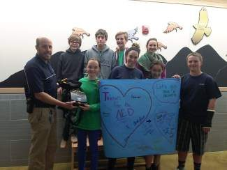 Chris Dick, Eagle County Public Safety Council chairman hands an automated external defibrillator to the Eagle County Charter Academy  student council for their new school building.The AED was provided to the Public Safety Council, by the Central Mountains RETAC, through a grant funded by the Colorado Rural Health Center.  This AED will be a truly public access defibrillator and can be accessed by any person to be used in a sudden cardiac arrest situation.