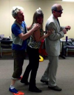 Lance Schober, Trish Schultheis and John Tedstrom rehearse a scene for