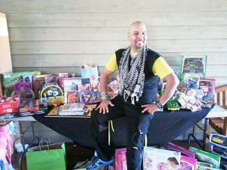 """Angel Caro donated a Zumba class, """"Dance with the Children,"""" to collect toys for the Vail Valley Salvation Army's Adopt-a-Family Program. Many toys were donated and participants had a wonderful workout!"""