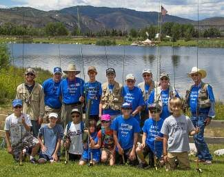 Campers and their mentors from the Eagle River Presbyterian Fly Fishing and Condervation Camp are all smiles after a day of fishing. On the extreme left of the photo is Minturn Anglers guide Braedon Marinson, who taught the future anglers casting skills. The camp, in it's third year, ran from July 15-19.