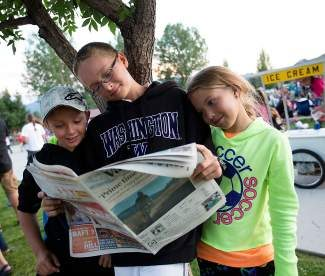 This trio was spotted at a free ShowDown Town concert, catching up on a great summer read. Check out tonight's prime time ShowDown Town concert at Eagle Town Park. The Original Shakedown Street takes the stage at 6:30 p.m.