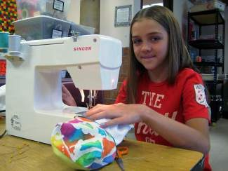 Fifth grader Ada Zastrow learns how to sew a zipper bag during Ms. Ikoniak's summer camps. For information about sewing camps, please call 970-306-9290.