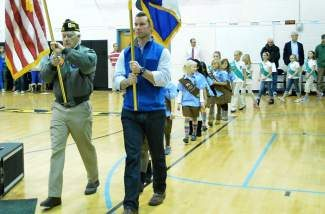 This year's Veterans Day ceremony is 3 p.m. today at Freedom Park in Edwards. This is Pete Thompson, left, and Mike Halas with the local VFW post on Friday morning leading a procession of Girl Scouts, Boy Scouts, Cub Scouts and Brownies to open an assembly at Eagle Valley Middle School and Eagle Valley Elementary School.