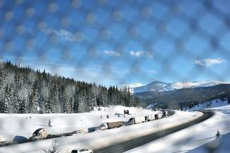The I-70 westbound lane is a parking lot while travelers wait because of an accident over Vail Pass. A vehicle went off a bridge on the pass, causing the gridlock to span over three hours.