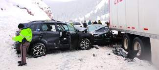 Around 15 vehicles, including a tractor-trailer rig, piled up in the westbound lane on Interstate 70 at Vail Pass near mile marker 186 Thursday.