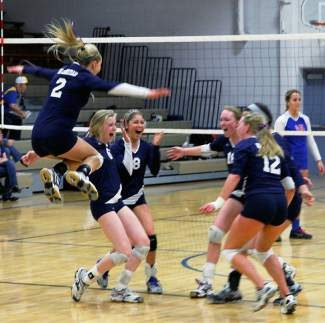 Vail Christian celebrates a win during the weekend's district playoff tournament. The Saints won two of three matches and earned a spot in next weekend's regionals.