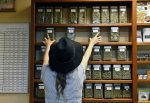 An employee arranges glass display containers of marijuana on shelves at a retail and medical cannabis dispensary in Boulder. According to survey data published online Wednesday in the scientific journal The Lancet Psychiatry, marijuana use is becoming more accepted among adults as states have loosened pot laws.