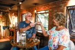 Jim and Janet Rodgers, of San Diego, sample spirits from 10th Mountain Whiskey & Spirit Co. on Sunday, Sept. 25, at the tasting room in Vail. The couple was trying the infusions, of which they said peach cobbler was their favorite.