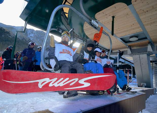 The first chair crew, minus 20-year veteran Nate Dogggg, waits for the Black Mountain Express to start spinning at Arapahoe Basin just before 9 a.m. on Oct. 21. Roughly 3,000 skiers and snowboarders came to A-Basin for opening day under blue skies.