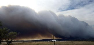 Heavy smoke from the Junkins Fire billows across the foothills along Siloam Road west of Pueblo, Colo., Monday, Oct. 17, 2016. (AP Photo, Chris McLean/The Pueblo Chieftain via AP)