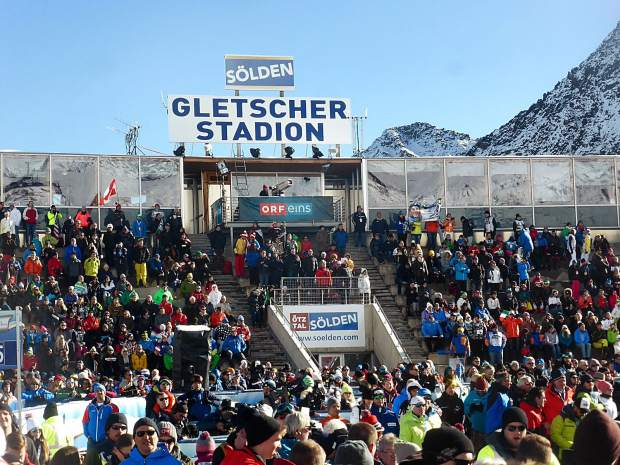 Fans cheer the racers in the jam-packed Glacier Stadium in Soelden, Austria, on Saturday.