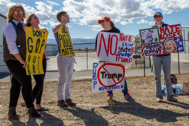 Protesters outside of the Donald Trump rally in Grand Junction Tuesday afternoon.