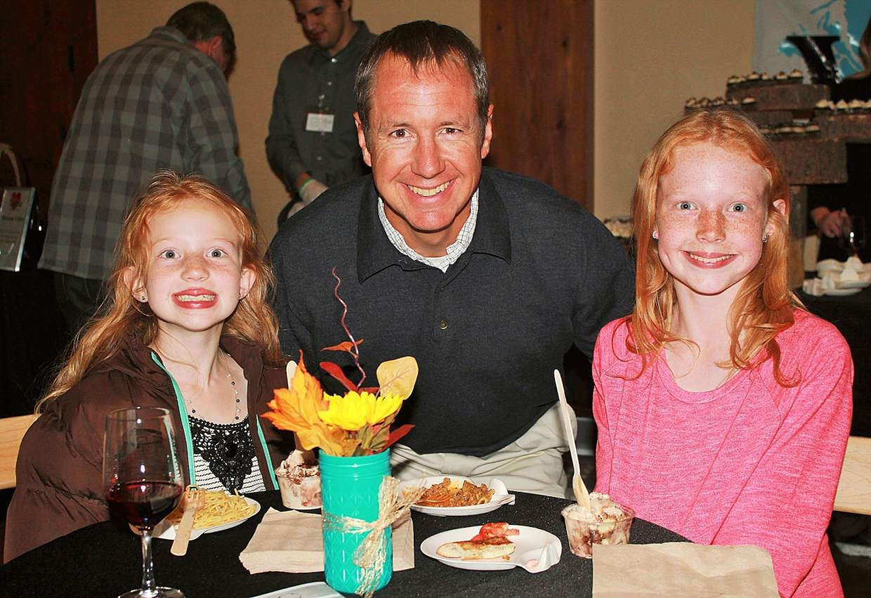 Michael Glass, president of Alpine Bank, and his daughters enjoy Valley Tastings: Food for Youth. Alpine Bank was a leading sponsor of the event and helped present the Outstanding Youth Awards.