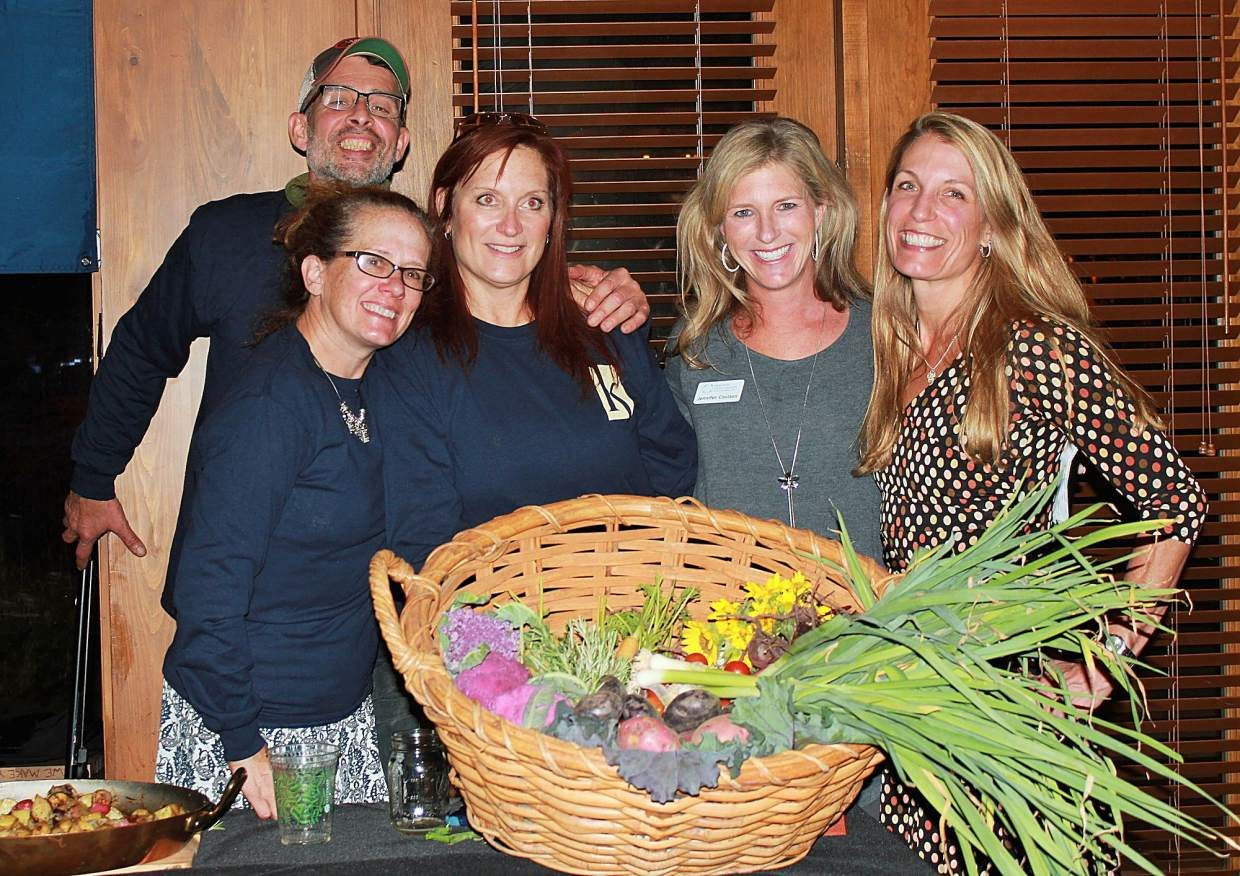 The Farm at Knapp Ranch served roasted locally grown potatoes that were picked that day and also donated a Garden Harvest as a live auction item. From left, Luis Juarez, Sandy Story, Karen Tejeda, Eagle River Youth Coalition board member and event emcee Jennifer Coulson and Sara Manwiller.