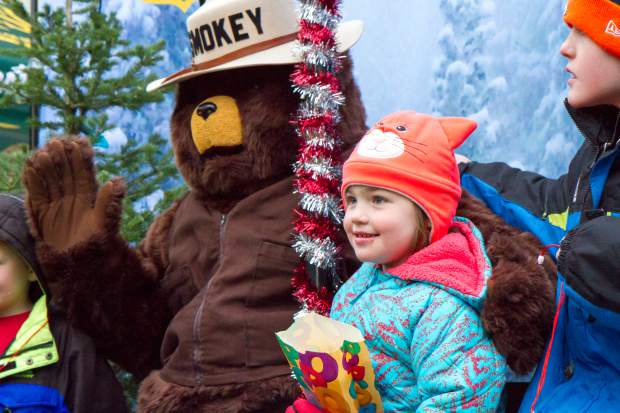 Five-year-old Natalie Schlepp gets her picture taken with Smokey Bear at the Glenwood Springs Welcomes the 2016 U.S. Capitol Christmas Tree event in Centennial Park. The tree that is headed to the Capitol is an 80-foot spruce that came from the Payette National Forest in Idaho and will be making its way to Washington, D.C., with several stops along the way, including Denver tomorrow. The events in the park included s'mores, a tunnel of lights, live music by Symphony in the Valley and the Glenwood Springs High School Jazz Band, as well as arts and crafts for kids. The event was put on by the city of Glenwood Springs and the White River National Forest. For more photos and a video go to postindependent.com