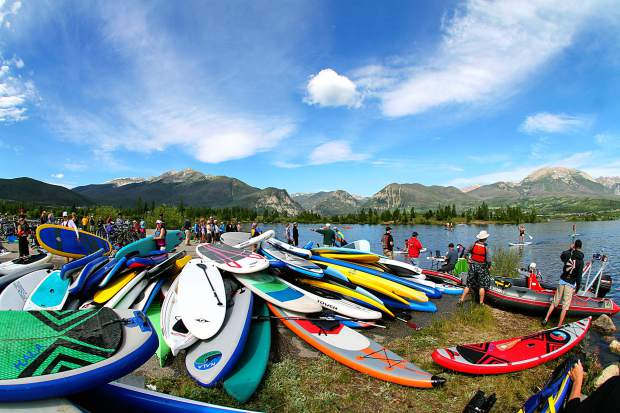 The SUP pile at the 2015 Frisco Triathlon on Lake Dillon in 2015. This season, SUP manufacturers have experimented with larger decks and more features, including boards made specifically for fly-fishing, and all require proper storage to extend the product's life.