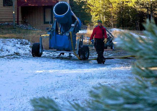 Michelle Vona of the Breckenridge Nordic Center checks a mobile snowmaking fan near the Nordic center lodge on Nov. 4. The center started making snow for the first time this season early on the morning of Nov. 4 and hopes to have full coverage in time for opening day around Thanksgiving.