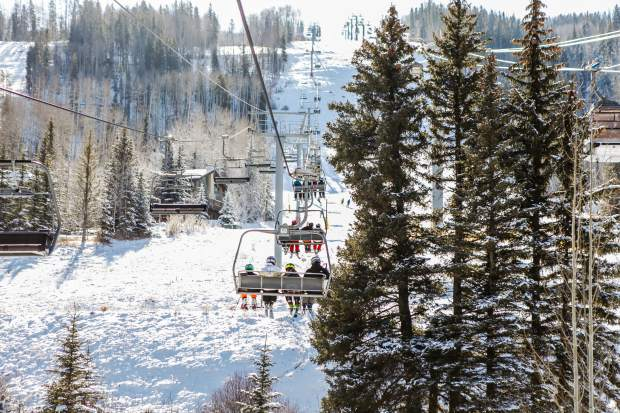Guests ride up Born Free lift on Vail's Opening Day on Friday in Lionshead. The lift accesed Born Free run, while the gondola was open for sightseeing.