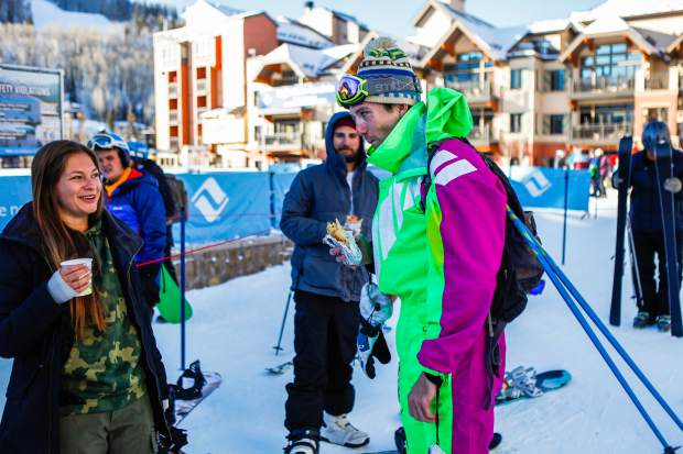 Matt Green, of Denver, and Katie Fitch, of Vail, get into the mood for the season during Opening Day of Vail on Friday in Lionshead. Burritos, hot chocolate and other swag was handed out to early risers.