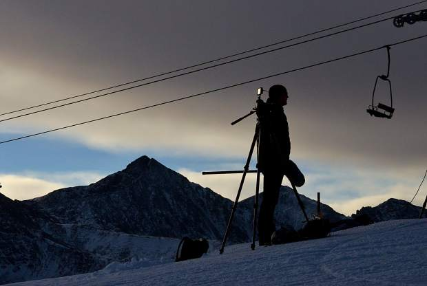 A cameraman sets up just before the sun rose over Copper Mountain during U.S. Ski Team training at the resort's Speed Center.