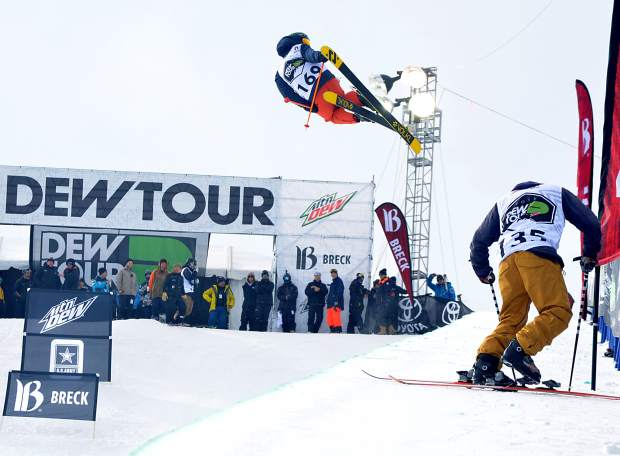 Jaxin Hoerter of Breckenridge airs out of the pipe while Canadian Noah Bowman clips in during practice runs before the men's freeski superpipe at Dew Tour in Breckenridge in 2015. Wednesday, Dew Tour officials canceled the 2016 superpipe competiiton due to late and low snowfall.