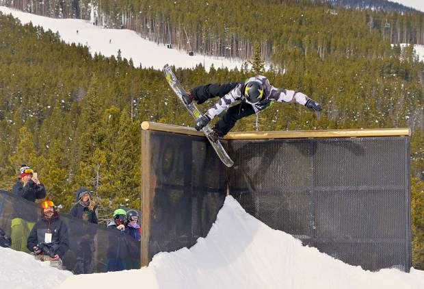 Ride team rider Brandon Davis tweaks an alley-opp on the 90-degree wallride feature on the Dew Tour jib course. Davis and teammate Reid Smith took third overall at the brand-new snowboard Team Challenge on Sunday at Breckenridge.