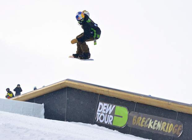 Nitro team rider Markus Kleveland spins a 270 onto the down rail in the first section of the Dew Tour jib course at Breckenridge. Kleveland and teammate Sebastien Toutant combined to take second overall at the brand-new snowboard Team Challenge on Sunday.