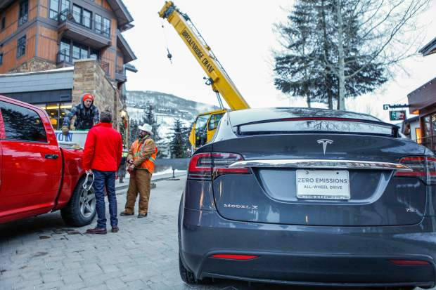 The Tesla Model X 75D is prepared to be hoisted onto the second level of Solaris in Vail.