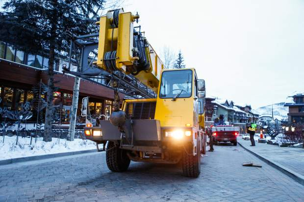 The crane arrives to hoist a Tesla onto the second level of Solaris in Vail. Breckenridge Crane Service provided the cranes and manpower to lift the vehicle.