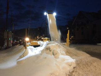 Town crews worked Thursday night to clear the massive amounts of snow that Vail has received.