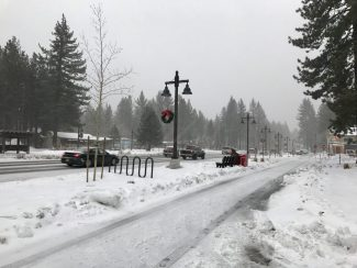 A light dusting of snow coats Lake Tahoe Boulevard in South Lake Tahoe Monday.