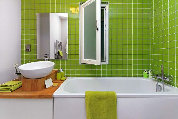Take a bold approach by retiling your bathroom with citrus green tiles.