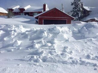 Up in Truckee's Tahoe Donner, snow was piled so high Wednesday afternoon it reached the second floors of homes.