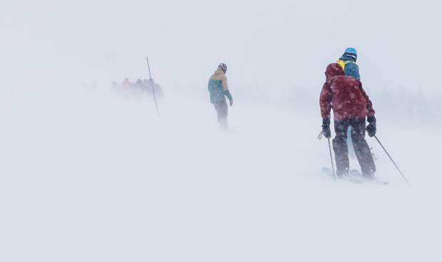 People make their way in a blizzard off China Bowl on Tuesday in Vail. Driving winds and snow greated skiers at the top of the Back Bowls in Vail.