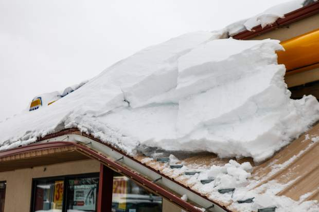Snow proved to be too much for a roof on a strip mall on Tuesday in Eagle-Vail. Temperatures were warm enough for rain in the beginning of the storm, which lead to dense snow.