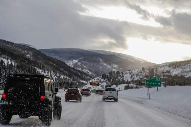 Traffic on I-70 moves slowly after a powerful winter storm rolled through the state on Tuesday in Vail. More snow is forecasted through Friday.