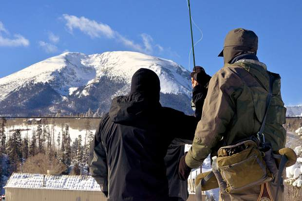 Fly-fishing guide Freddy Santen (right) teaches 14-year-old Noah Rawls of Texas basic casting techniques before a winter fly-fishing tour on the Blue River in December. Santen, a guide with Breckenridge Outfitters, leads tour groups all year long.