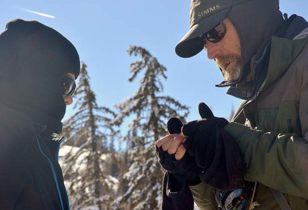 Breckenridge Outfitters guide Freddy Santen (right) helps 14-year-old Noah Rawls attach a fly before casting on the Blue River in December. Anglers can find year-round quarry in Summit County, Santen said, thanks to fast-moving (and unfrozen) waters like the tail waters of the Blue just below the Dillon Dam in Silverthorne.