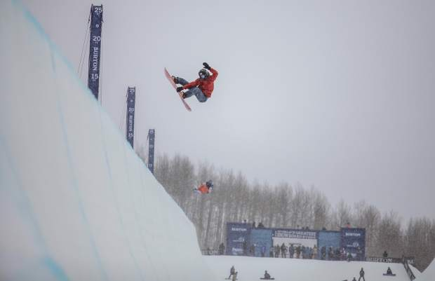 Professional Snowboarder Danny Davis floats a grab during practice laps on the first day of the Burton U.S. Open Snowboard Championships Monday in Vail. Halfpipe semi-finals are Thursday and finals Saturday.