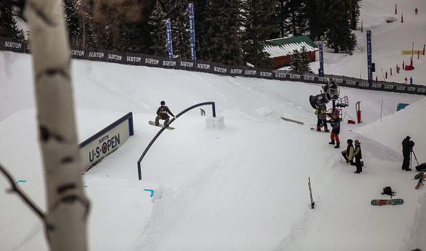 Snowboarders take practice runs down the slopestyle course on the first day of the Burton U.S. Open Snowboard Championships Monday in Vail.