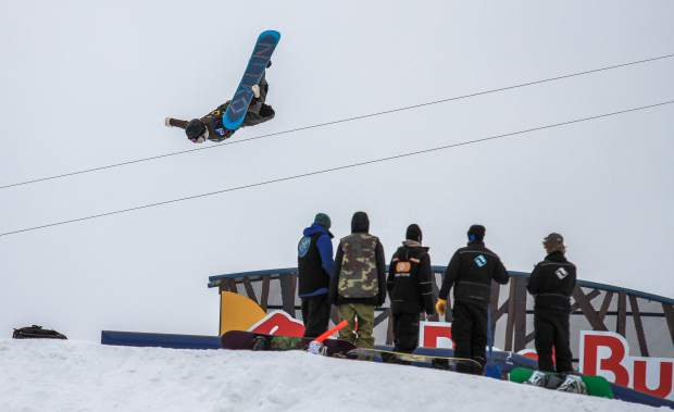 Snowboarders practice their tricks on the slopstyle course during the practice runs on the first day of the Burton U.S. Open Snowboard Championships Monday in Vail. Slopestyle semi-finals are Wednesday and finals Friday.