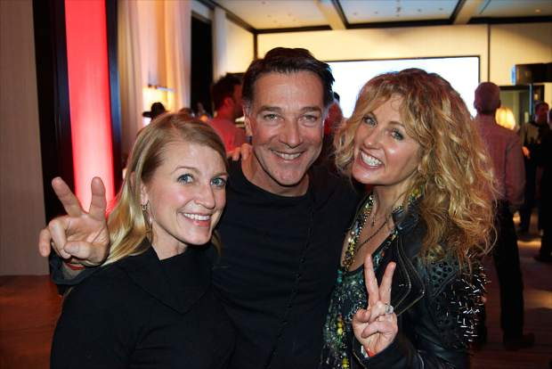 Tricia Swenson, left, catches up with Australian fans Paul and Megan Castran at the Rock-N-Remedy Guster concert at the Four Seasons Resort in Vail.