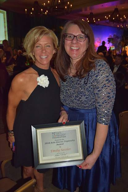 Cindy Bellenger congratulates Emily Sessler on being presented with the 2016 Arte Davies Ingenuity Award by the Vail Valley Foundation at the Black Diamond Ball.