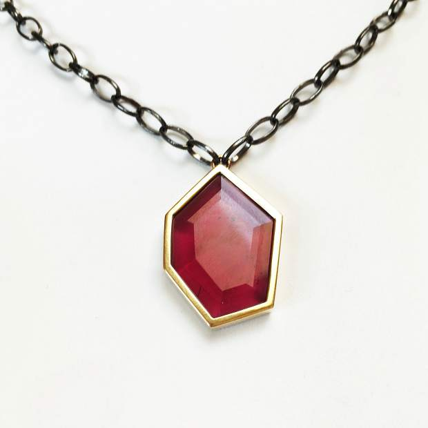 Syrah Necklace, 21.04-carat fine rubellite set in 18-karat yellow gold with black rhodium-plated sterling silver chain.