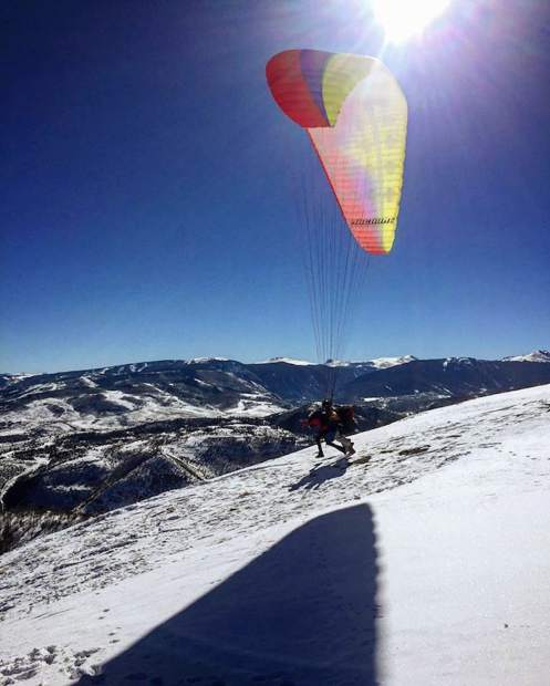 @edtizzle: In a place with endless recreation opportunities, this is easily the coolest thing I've done. @meghanrcahill nears take off this morning. #VailLive